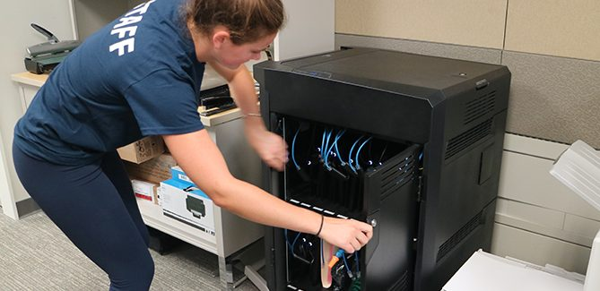 Student Opens Laptop Cart