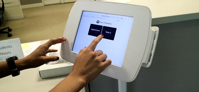 Student Checks in at Digital Kiosk